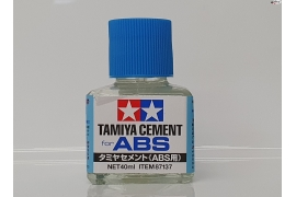 Tamiya cement for ABS plastics.