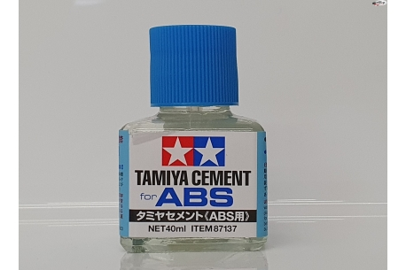 Tamiya cement for ABS plastics.